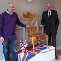 Chair creator Dave Green, left, and RFS President Nick Halsey, right, with the unique Windsor chair commissioned by the RFS to mark Her Majesty the Queen's Diamond Jubilee